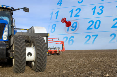 stock-photo-15583761-large-tractor-and-corn-planter-on-tilled-field